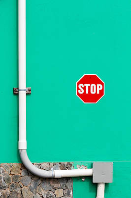 Stop Sign Photograph - Vibrant Red Stop Sign On Bright Green Wall by Anya Brewley schultheiss
