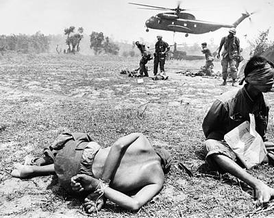 Que Photograph - Vietnam War: Prisoners by Granger