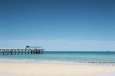 Getting Away From It All Photograph - View Of A Pier From A Sandy Beach by Caspar Benson