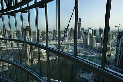 Cranes And Derricks Etc Photograph - View Of High Rises And Construction by Mattias Klum
