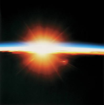 View Of The Sunrise From Space Print by Stockbyte