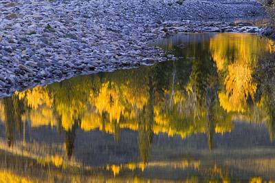 Water Reflections With A Rocky Shoreline Print by Carson Ganci