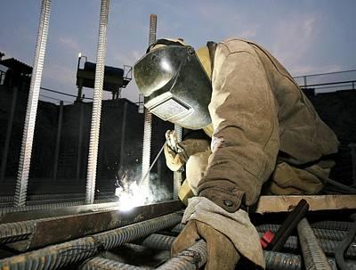 Welder Working On A New Bridge Print by Ria Novosti