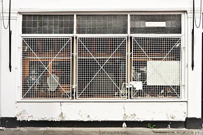Brick Building Photograph - Window Bars by Tom Gowanlock