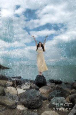 Woman By The Sea With Arms Reaching Up In Praise Print by Jill Battaglia