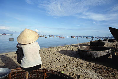 Woman In Conical Hat Sitting On Boat On Print by Axiom Photographic