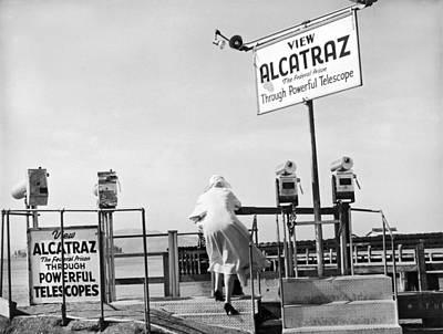 Alcatraz Photograph - Woman Looking At Alcatraz by Underwood Archives