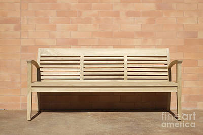 Wooden Bench Set Against Brick Wall Print by Jeremy Woodhouse