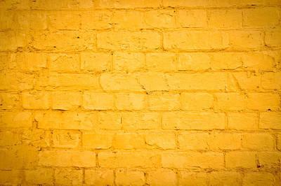 Brick Buildings Photograph - Yellow Wall by Tom Gowanlock