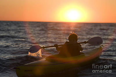 Boat Photograph - Young Boy Kayaking At Sunset by Christopher Purcell