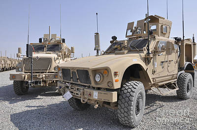 Armored Fighting Vehicles Photograph - An M-atv Mine Resistant Ambush by Stocktrek Images