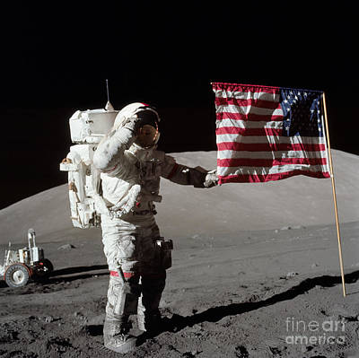 Outer Space Photograph - Apollo 17 Astronaut Salutes The United by Stocktrek Images