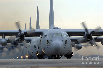 In A Row Photograph - C-130 Hercules Aircraft Taxi by Stocktrek Images