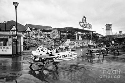 Empty Outdoor Amusement Park On A Cold Wet British Summer Day North Wales Uk Print by Joe Fox