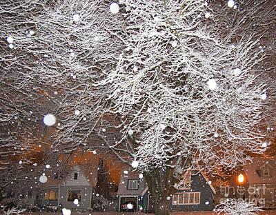 Falling Snow In A Neighborhood Print by David Buffington