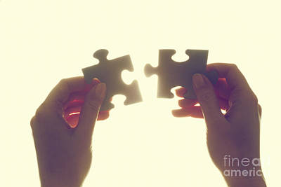 Joining Two Pieces Of Jigsaw Puzzle Print by Michal Bednarek