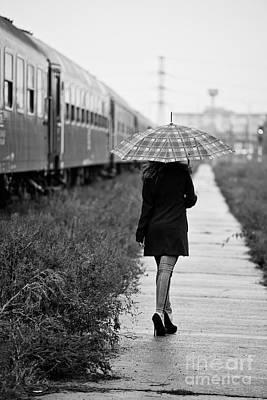 Rainy Day Photograph - Leaving by Gabriela Insuratelu