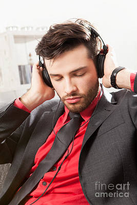 Man In Suit Listening To Music With Headphones Print by Wolfgang Steiner