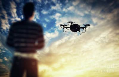 Male Photograph - Man Operating A Drone At Sunset. by Michal Bednarek