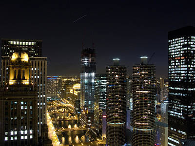 Magnificent Mile Photograph - Skyscrapers In A City Lit Up At Night by Panoramic Images