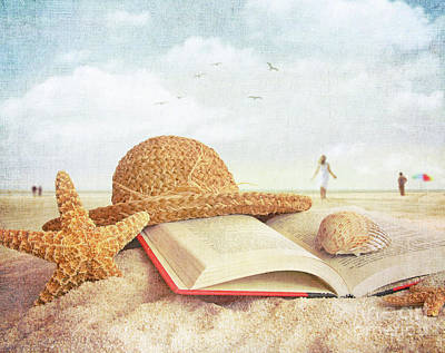 Straw Hat Book And Seashells In The Sand Print by Sandra Cunningham