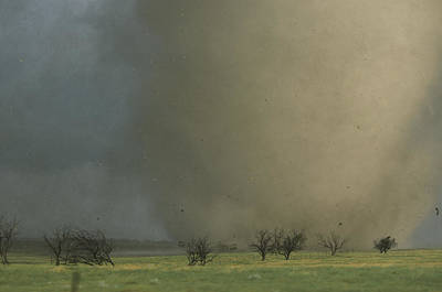 Natural Forces Photograph - An F4 Category Tornado Barrels by Carsten Peter