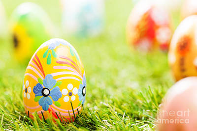 Beautiful Flower Photograph - Colorful Hand Painted Easter Eggs In Grass by Michal Bednarek
