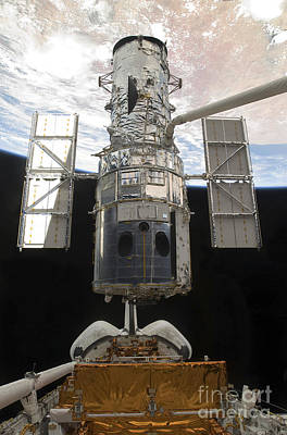 Space Exploration Photograph - The Hubble Space Telescope Is Released by Stocktrek Images