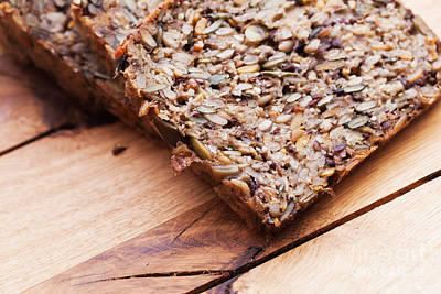 Baked Photograph - Wholemeal Bread On Wooden Table by Michal Bednarek