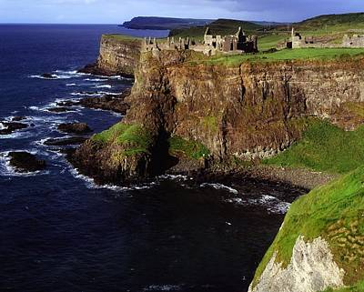 Remoteness Photograph - Dunluce Castle, Co. Antrim, Ireland by The Irish Image Collection