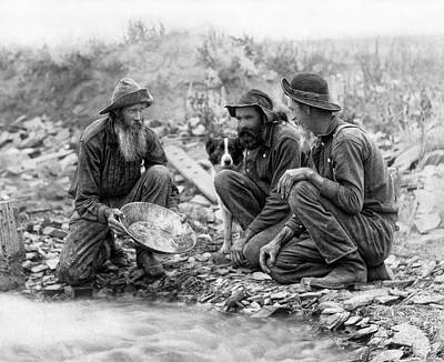 3 Men And A Dog Panning For Gold C. 1889 Print by Daniel Hagerman