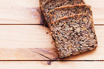 Wood Photograph - Wholemeal Bread On Wooden Table by Michal Bednarek