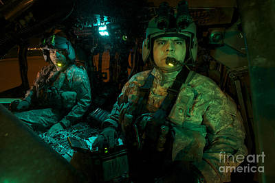 Pilots Sitting In The Cockpit Print by Terry Moore