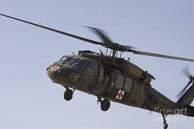 A Uh-60 Blackhawk Medivac Helicopter Print by Terry Moore