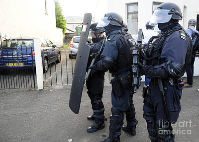 Police Officer Photograph - Loyalist Protesters Attack Police Lines by Andrew Chittock
