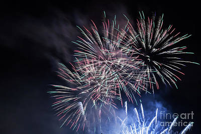 July Photograph - Spectacular Fireworks Show Light Up The Sky. New Year Celebration. by Michal Bednarek