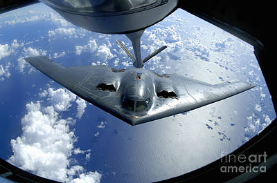 Stratotanker Photograph - A B-2 Spirit Moves Into Position by Stocktrek Images