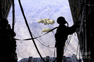 People Watching Photograph - A C-130 Hercules Loadmaster Observes by Stocktrek Images