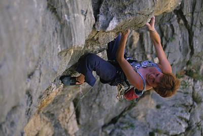 A Caucasian Woman Rock Climbing Print by Bobby Model