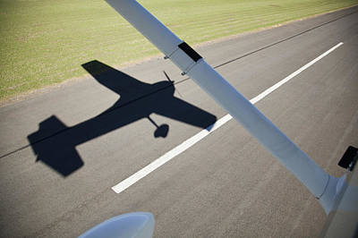 On The Runway Photograph - A Cessna Light Aircraft Taking Off The Shadow Tells The Story by Richard Du Toit