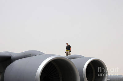 Stratotanker Photograph - A Crew Chief Walks The Wing Of A Kc-135 by Stocktrek Images