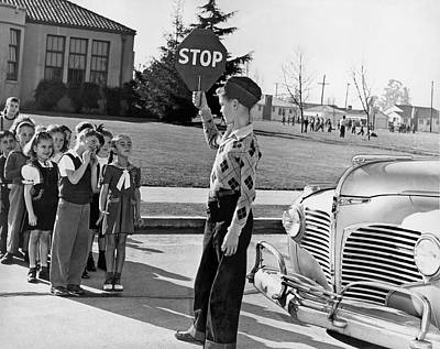 A Crossing Guard Holds Up Sign Print by Underwood Archives
