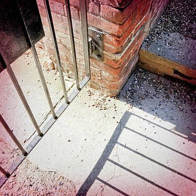 A Gate With Shadows Print by Tom Gowanlock