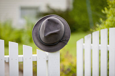 A Hat Hanging On The Post Of A White Print by Lorna Rande
