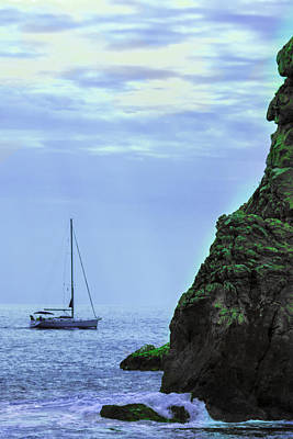 A Summer Evening Photograph - A Lone Sailboat Floats On A Calm Sea by George Westermak