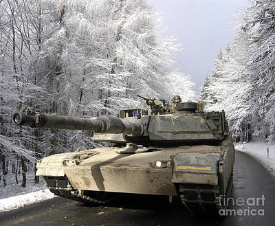 Armored Fighting Vehicles Photograph - A M-1a Abrams Tank Drives by Stocktrek Images