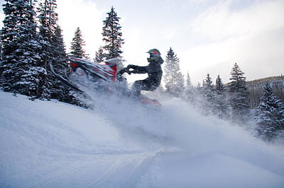 Snowmobile Photograph - A Man Jumps Across A Road by Taylor S. Kennedy