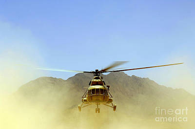 A Mi-17 Hip Helicopter Hovers Print by Stocktrek Images