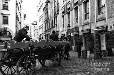 A Ride In Munich Print by John Rizzuto