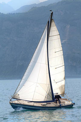 Photograph - A Sailing Boat Is Sailing Over The Lake Garda by Regina Koch